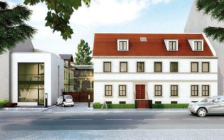 Alt und Neu: Rechts das denkmalgeschützte Wohnhaus des einstigen Meierei-Besitzers Spiegel, links ein moderner Neubau mit ein bis zwei Ladenflächen. Dazwischen befindet sich der Zugang zum Innenhof.